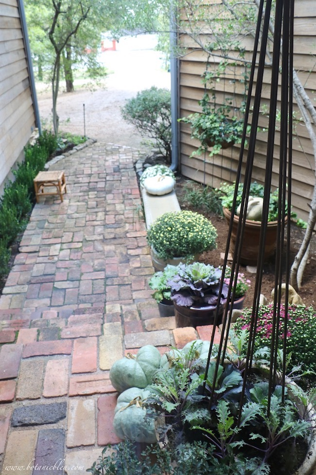fall front porch decorating ideas with color on antique brick porch and walkway