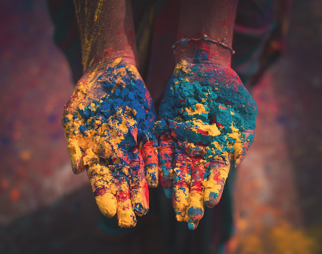 Holi colours in hand