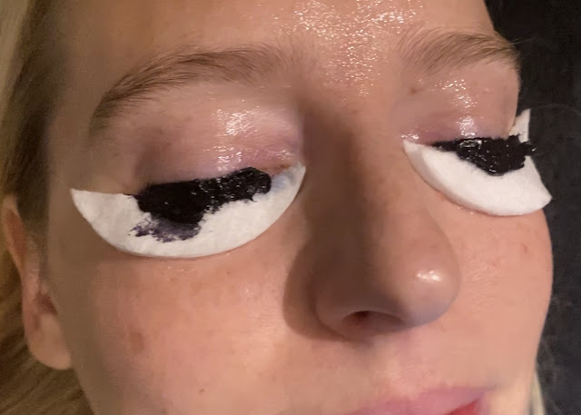 Me with my eyes shut, cotton wool under my eyes and black dye on my eye lashes for a lash review at Strip