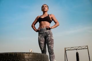 Woman that stands strong after an intense exercise session