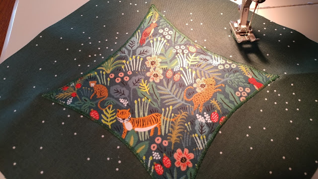 applique quilt using Menagerie fabric by Rifle Paper Co.