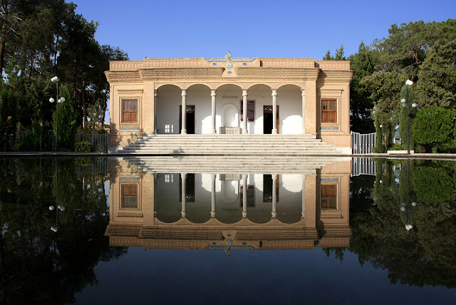 The Zoroastrian fire temple reflected in the water.