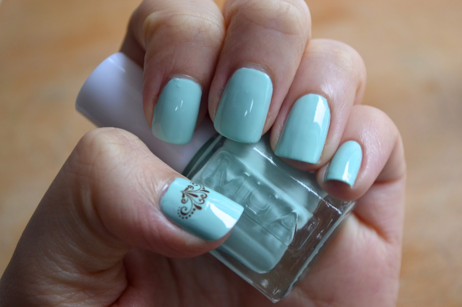 bigRuby Nail Tattoos on mint green nail polish