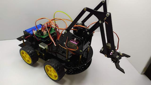 DIY Robot Arm Car for Arduino with PS Wireless Remote Control سيارة مع دراع آلية و الة التحكم لاسلكية  روبوت