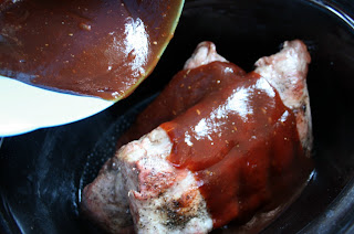 Crockpot Slow Cooker Barbecue Ribs - sauce being poured over ribs
