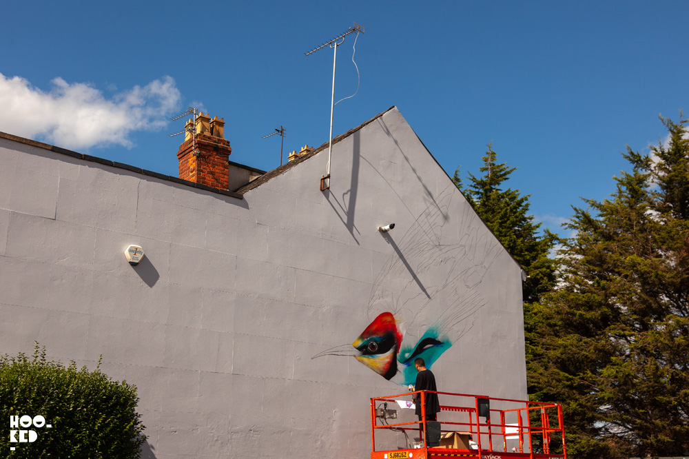 Street artist L7M at work on a Street Art Mural in Cheltenham