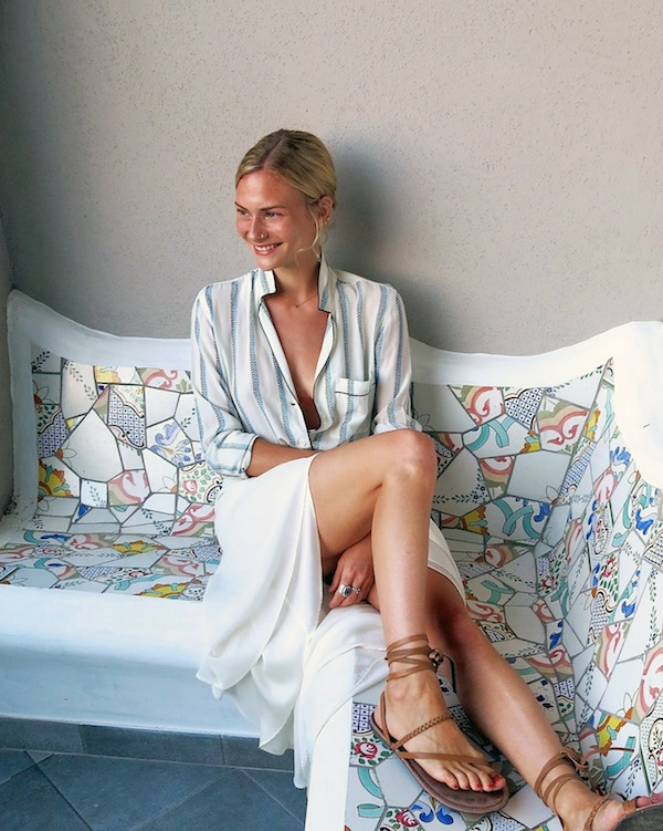 Stylish Summer Outfit Idea — Pandora Sykes in a striped shirt, white skirt, and ankle-wrap flat sandals