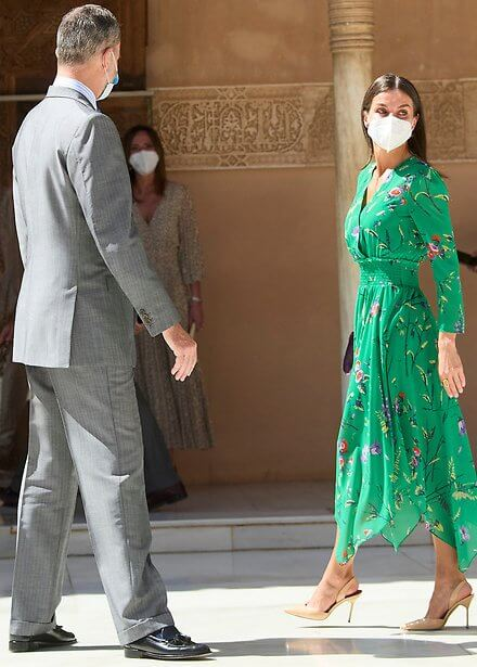 Queen Letizia wore a green floral prints silk midi dress from Maje Paris. Awards ceremony at Alhambra Palace