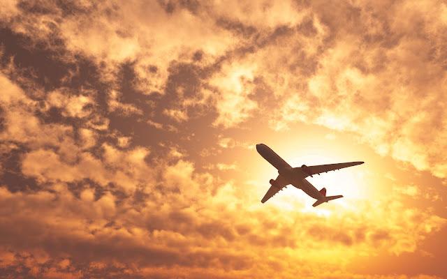 Avião e o sol