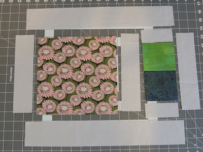 The placemat pattern uses a focus fat quarter and basic fabrics