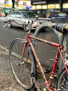 Chained bicycle on Roosevelt Avenue in Queens