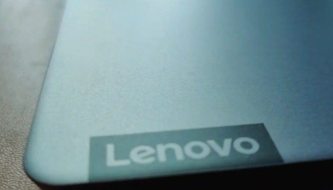 A smooth matte silver color aluminum surface of this laptop with Lenovo branding on the bottom right corner.