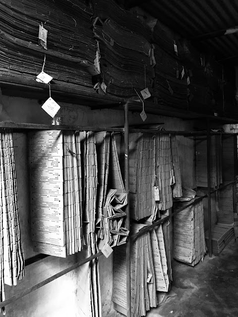 black and white photography, black and white, village, india, hand loom boards, one- point perspective
