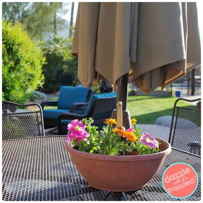 https://www.dazzlewhilefrazzled.com/diy-umbrella-table-flower-planter/