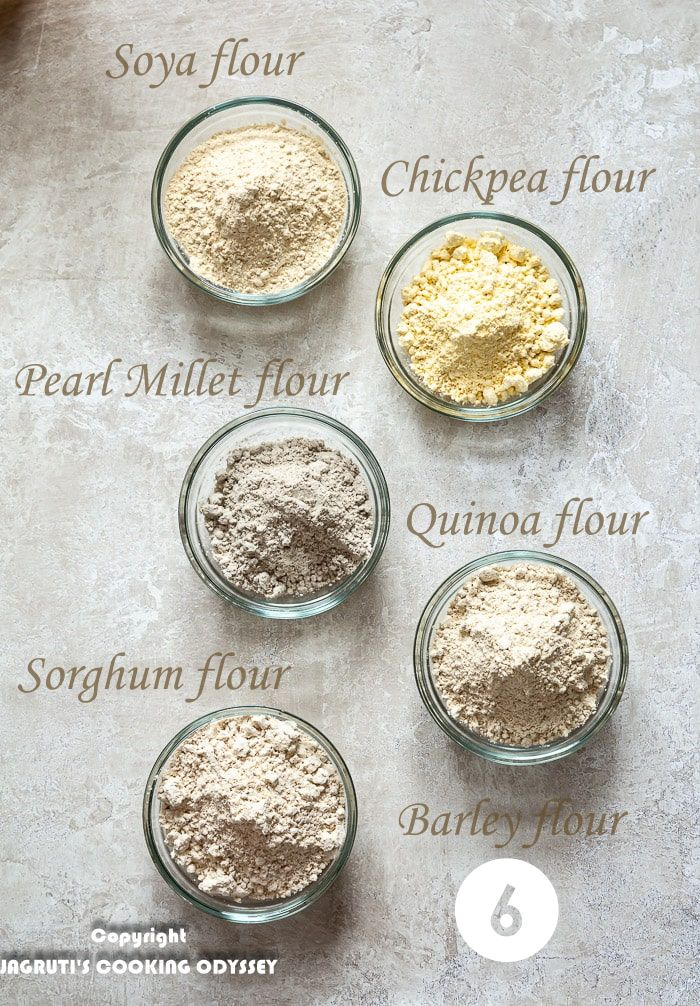 Six different grain flours in small six glass bowls