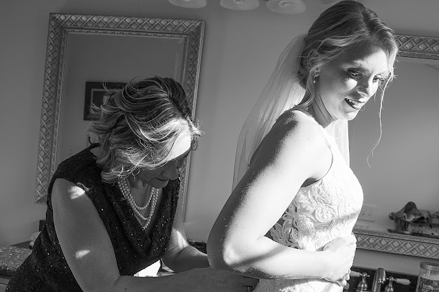 B&W Bride getting ready mother helping button Bride's dress Magnolia Farm Asheville Wedding Photography captured by Houghton Photography