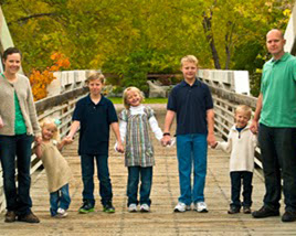 Cramer Imaging's example of a poorly cropped family portrait based on composition