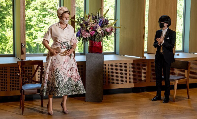 Queen Mathilde wore a beige silk belted printed skirt with embellished point long sleeve shirt from Dries van Noten
