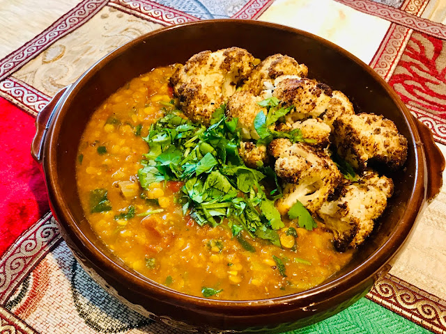 Tadka Dal - yellow lentils and tomatoes with Indian spices and chaat masala cauliflower