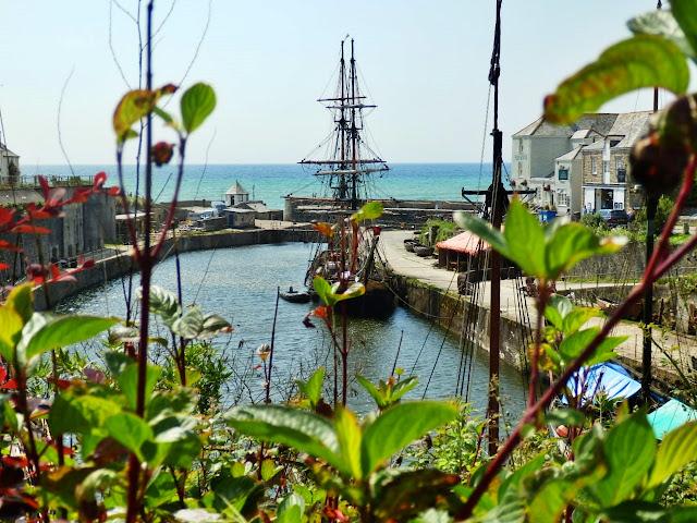 Tall sailing ship in port at Charlestown, Cornwall