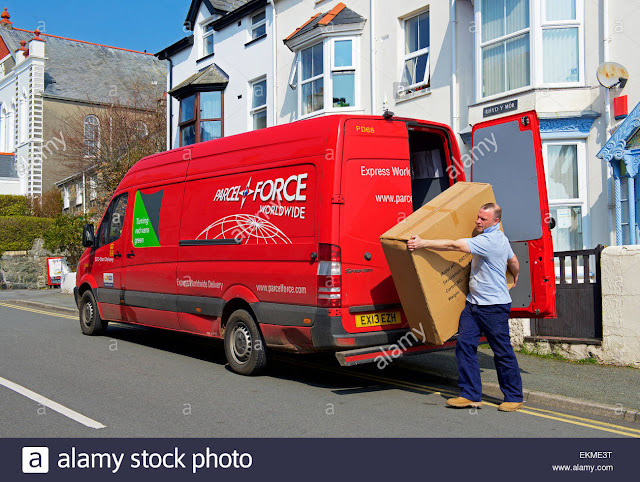 man-unloading-large-package-from-parcel-force-delivery-van-EKME3T-1.jpg