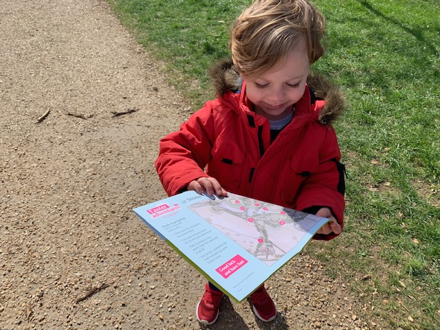 Little boy with Easter trail map
