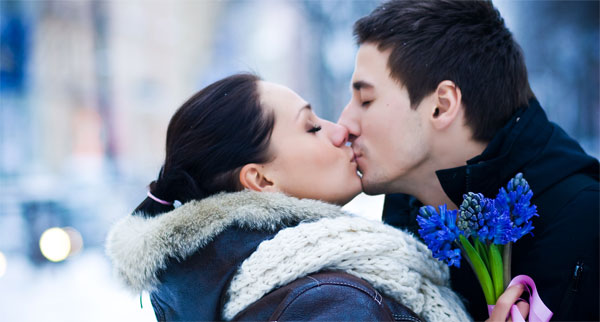 sweet romantic couple kissing in morning