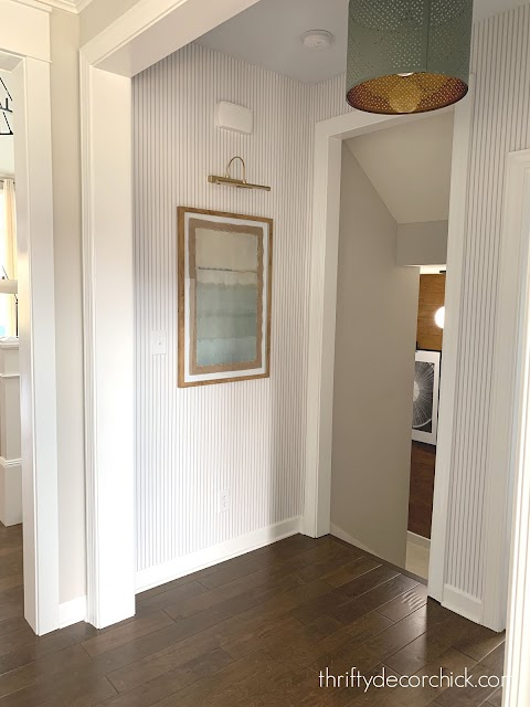 foyer with striped wallpaper