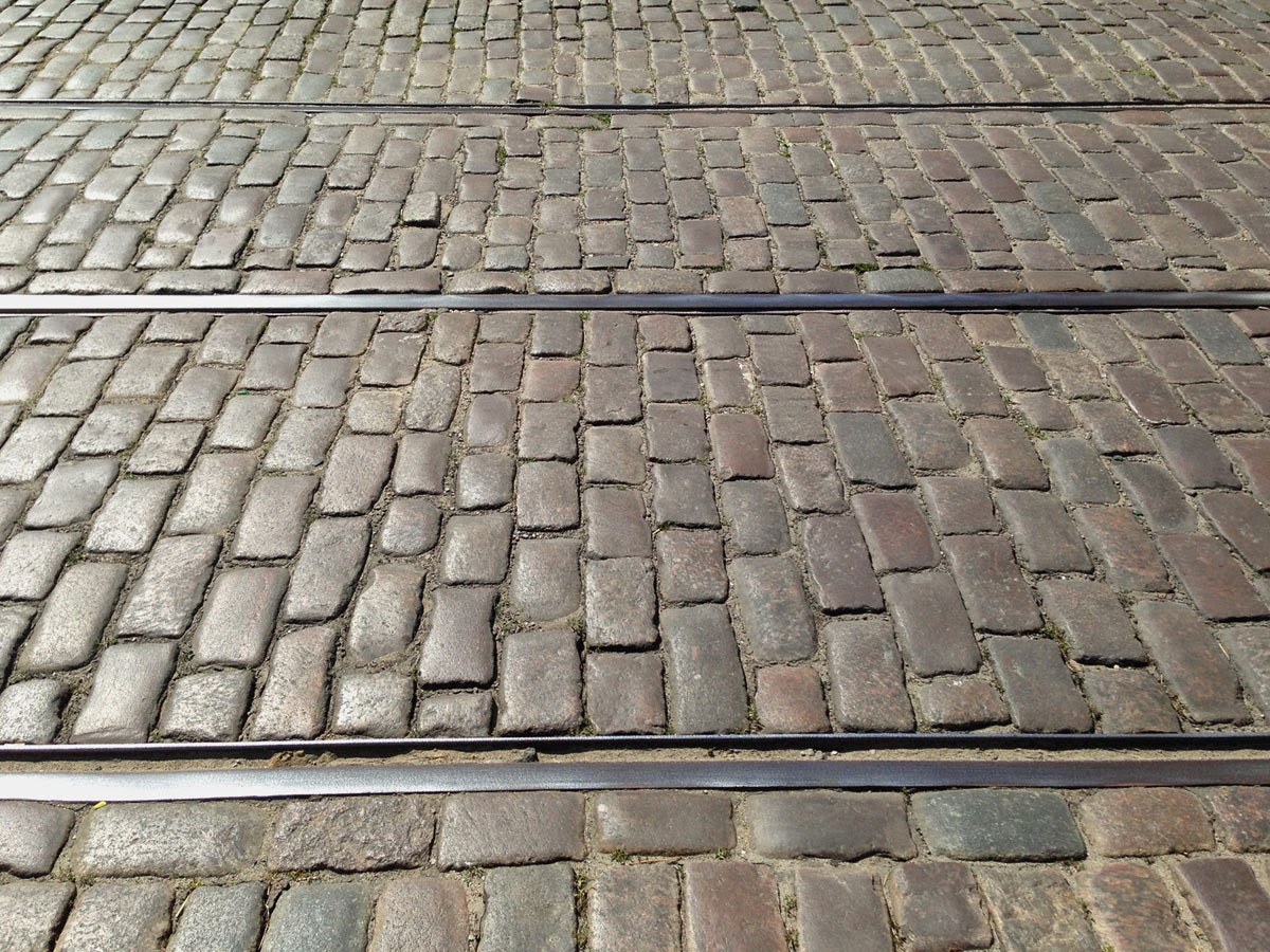 Tram Tracks and Cobblestones in Chlodna St. by Maja Trochimczyk