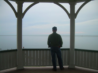 Chris standing in a gazebo looking at Lake Ontario