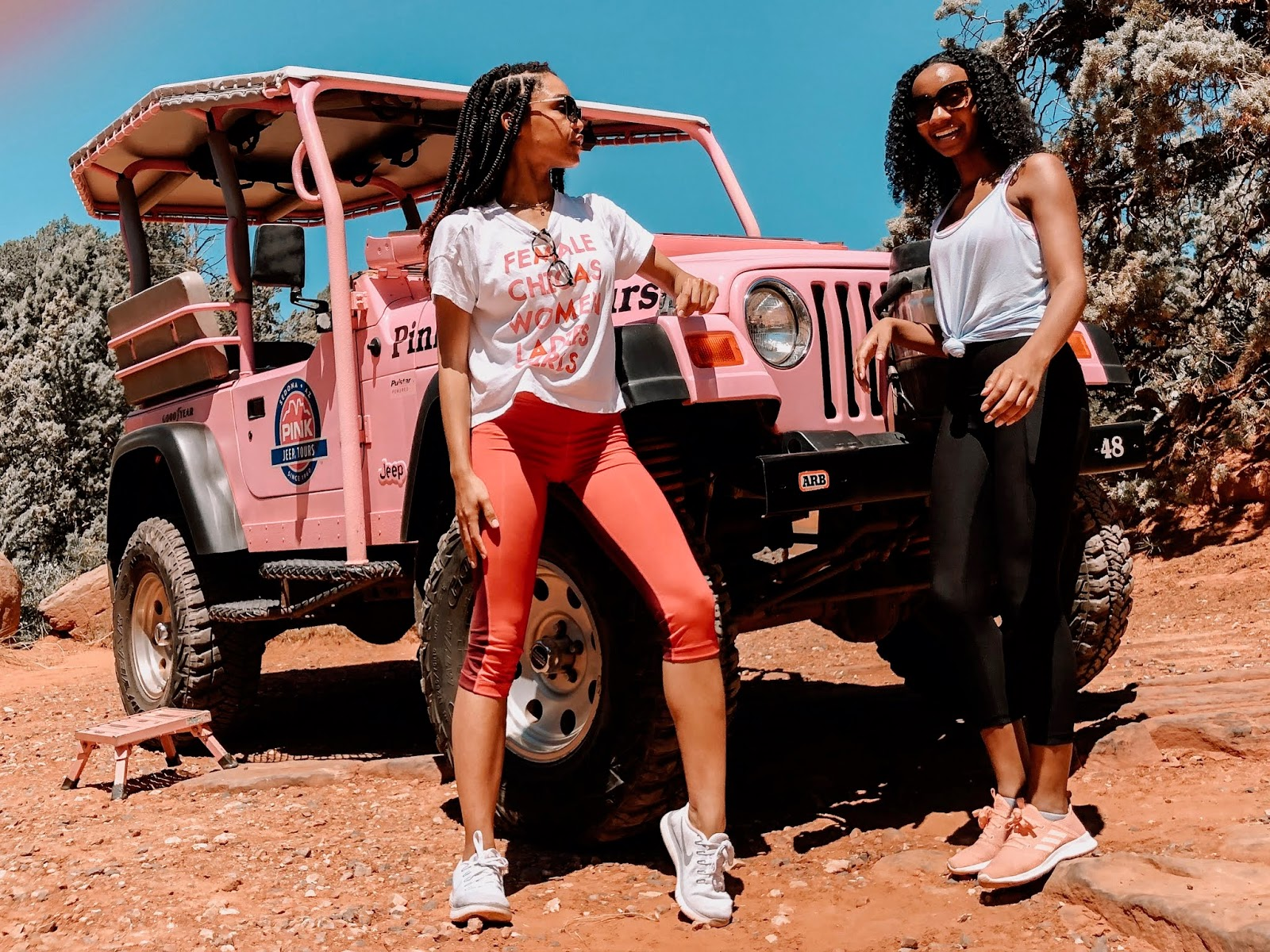 Posing in front of a pink jeep before the scenic rim tour