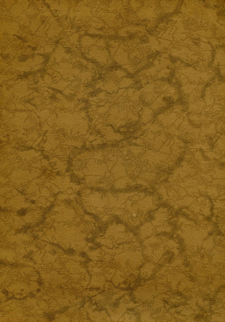 A pattern from a vintage paper in a golden or mustard brown, with darker brown veins running through it.