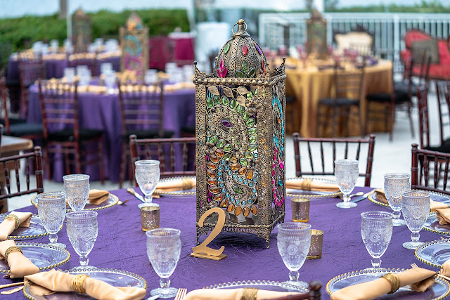 Colorful jewel tone outdoor reception close up table at Mansion at Tuckahoe in Jensen Beach, FL