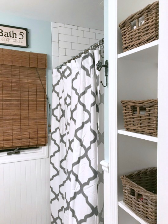 Tiny Master Bathroom Renovation with white subway tile and dark grout