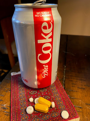 Photo of my breakfast: a can of Diet Coke and 7 pills