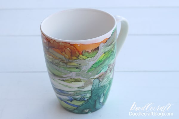 Use Alcohol inks to create a stunning work of abstract art on a ceramic mug for the perfect holiday gift. With full video tutorial instructions too!