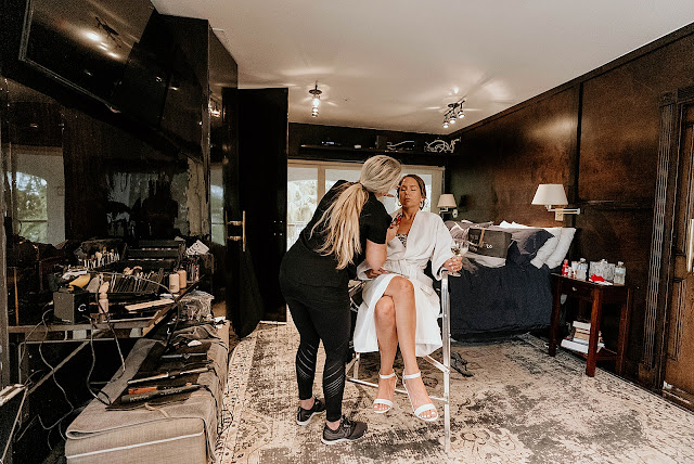Bride getting makeup done by Makeup artist The Manor on St Lucie Crescent Wedding captured by Stuart Wedding Photographer Heather Houghton Photography