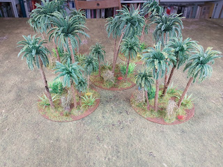 CDs form the bases for these jungle terrain pieces