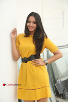 Actress Poojitha Stills in Yellow Short Dress at Darshakudu Movie Teaser Launch .COM 0127.JPG