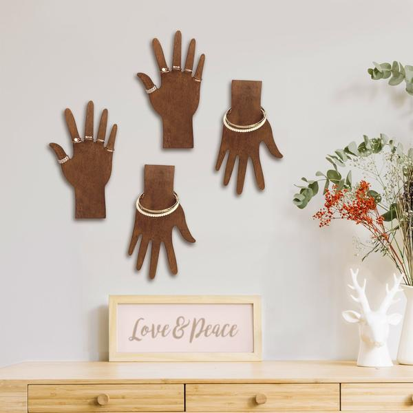 Wooden hand-shaped displays mounted on the wall