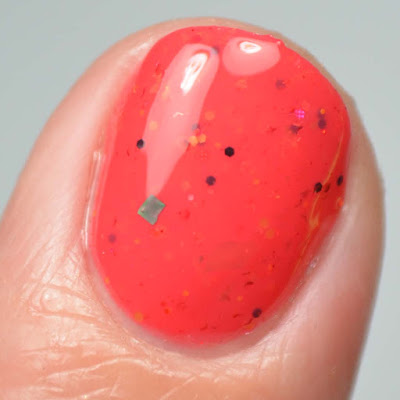bright coral nail polish close up swatch