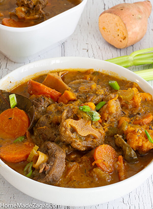 A filling oxtail soup made in the slow cooker creating a delicious broth and a tender cooked meat.