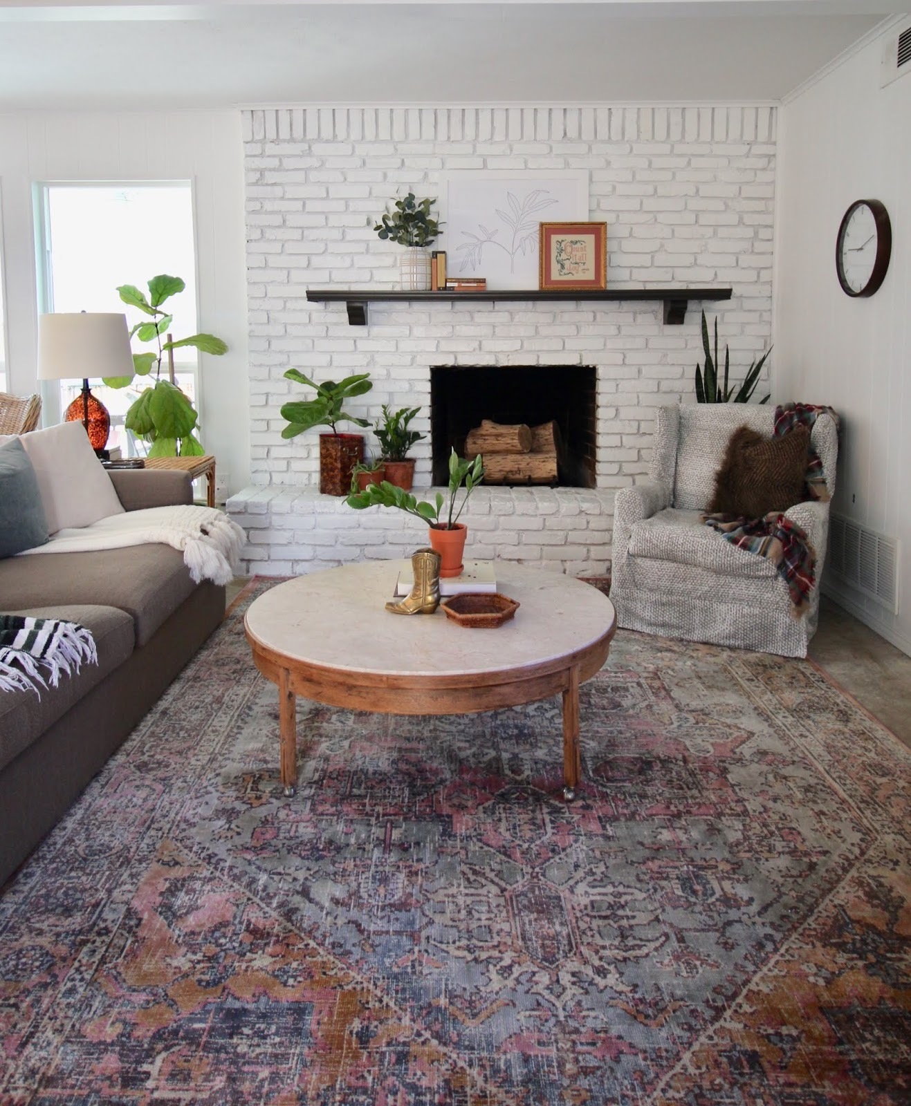 We've lived in our house a whole year!! Check out the tour and a round up of projects I've done. It's been great!   House Homemade fireplace mantel styling