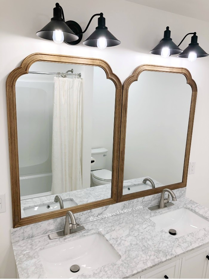 Mirrors and lights above vanity