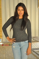 Actress Bhanu Tripathri Pos in Ripped Jeans at Iddari Madhya 18 Movie Pressmeet  0051.JPG