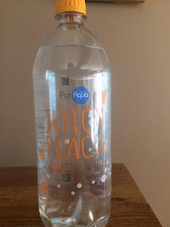 A bottle of PurAqua Juicy Peach Sparkling Water, from Aldi