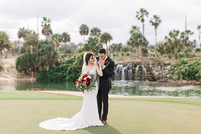 bride and groom taking photos on golf course