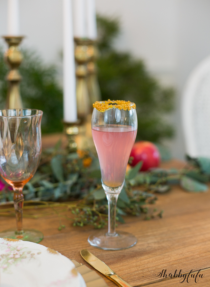 pink champagne glass with gold rim