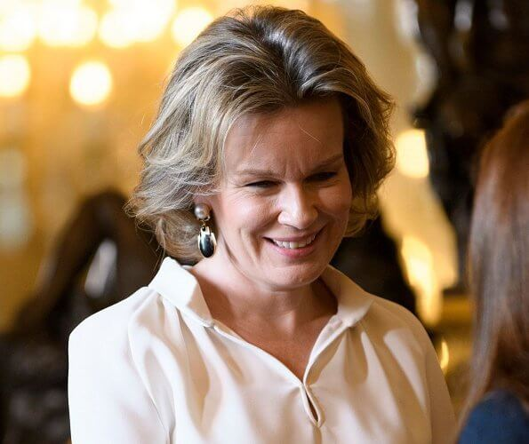 Queen Mathilde of Belgium held a new year's reception at the royal palace in Brussels. Queen Mathilde wore a skirt by Natan