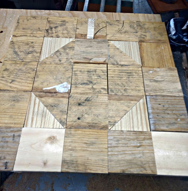 piece and glue pallet wood squares to a piece of plywood to make a fall quilt